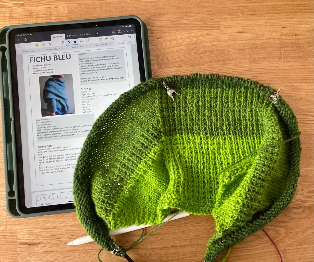 Image shows shawl in stockinette and broken rib in a green gradient